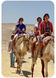 one-hour-camel-ride-desert-safari-tour-riding in dubai, camel trekking safari dubai